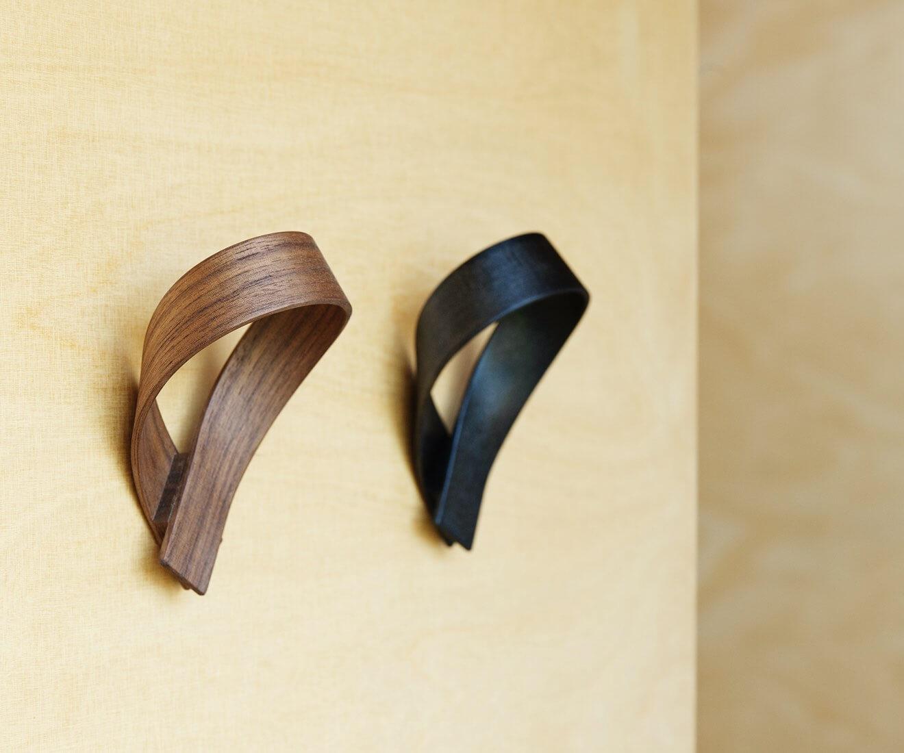 Interior photo of Motarasu designs - Ribbon coat hooks, walnut and black, by Akiko Ken Made