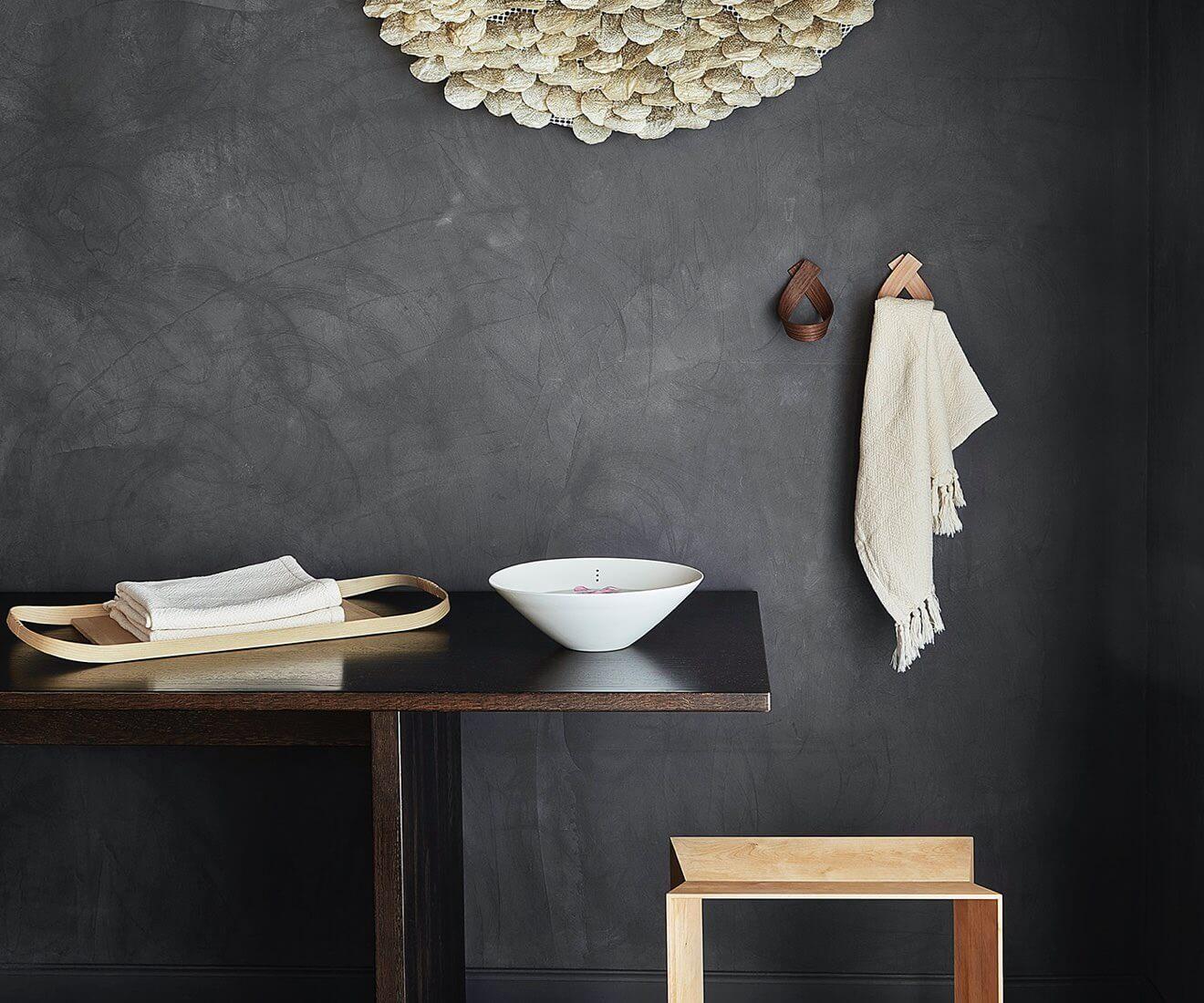Interior photo of Motarasu designs - Ribbon coat hooks, walnut and beech, by Akiko Ken Made - Shiro bowls by Stilleben - Union tray by Masuko Unayama - Reflex stool by Akiko Ken Made