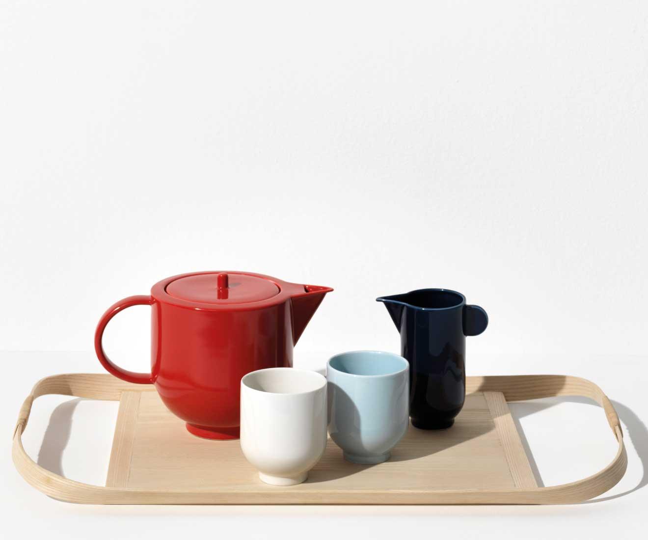 Interior photo of Motarasu designs - Yoko tea pot in red, pitcher in blue, Light blue and white mug by Stilleben - Union Tray by Masuko Unayama